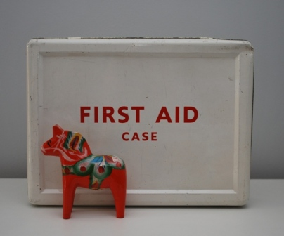 vintage first aid tin and dala horse from Lost Property Vintage